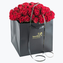 Red Roses In A Gift Bag