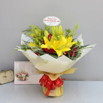 Yellow lilies with red and green